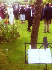 Ela's music stand at a wedding