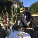 Tim getting trombone ready for garden party gig