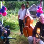 Relaxing between songs at garden party