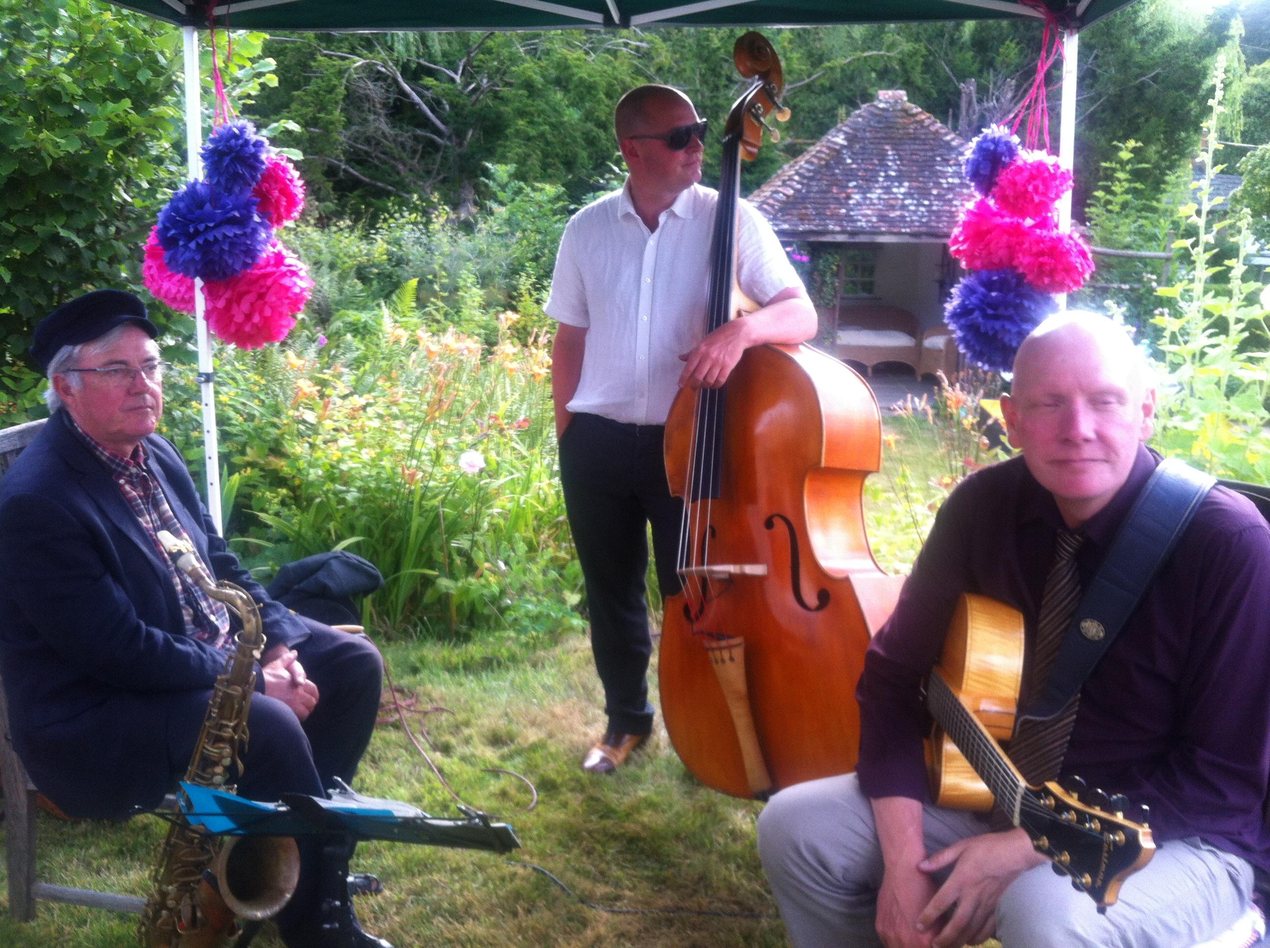 Relaxing between songs at garden party
